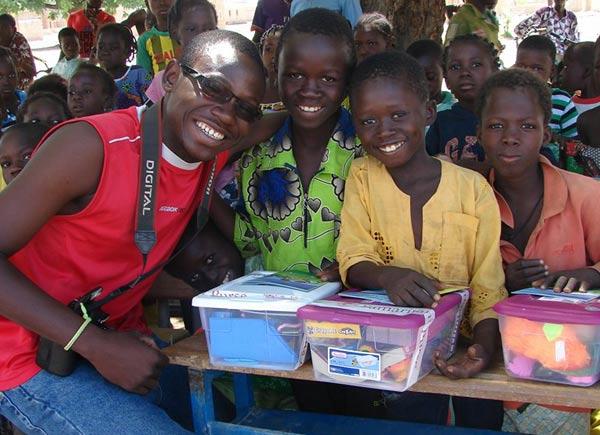 Désiré at a distribution with children